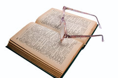 Spectacles and  book. Spectacles to reading text of book for protecting eyes Royalty Free Stock Images