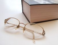 Spectacles AND BOOK. BIG BOOK AND  spectacles on white page Stock Images