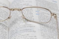 Spectacles. On the book,in concept Sharpness with Stock Photo