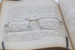 Spectacles. On the book,in concept Sharpness with Thai words is how to make glue from animal skin Stock Image