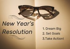 Spectacles on book with new year resolution goals Royalty Free Stock Photos