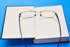 Spectacles and the book Stock Photos