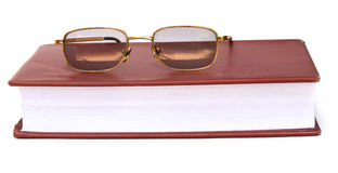 Spectacles on a book Royalty Free Stock Images