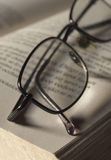 Spectacles on book page Stock Photography