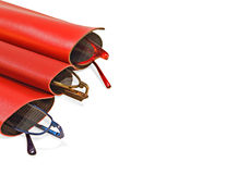 Spectacles in case. Three red spectacles cases with three different colored spectacles. Fashion or a metaphore for watching out better Stock Photography
