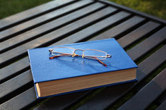 Spectacles on the closed book Royalty Free Stock Image