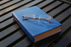 Spectacles on the closed book 2 Royalty Free Stock Photography