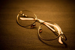 Spectacles on dark background Royalty Free Stock Images