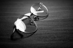 Spectacles on dark background Royalty Free Stock Image