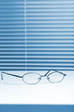 Spectacles on desk Royalty Free Stock Photos