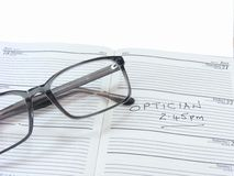 Spectacles on a Diary Royalty Free Stock Photo