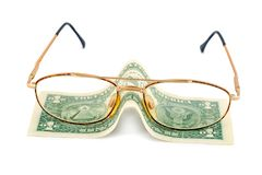 Spectacles dollar Stock Photos