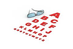 Spectacles on eye chart Stock Photo