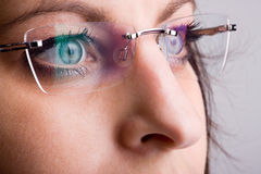 Spectacles with facial detail. Clear rimless spectacles with facial detail Royalty Free Stock Photos
