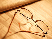 Spectacles on financial page Royalty Free Stock Image