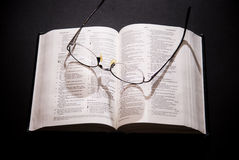 Spectacles and holy bible. Shot with dramatic lighting Royalty Free Stock Photo
