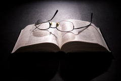 Spectacles and holy bible. Shot with dramatic lighting Royalty Free Stock Images