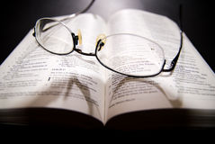 Spectacles and holy bible. Shot with dramatic lighting Stock Photos