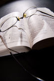 Spectacles and holy bible. Shot with dramatic lighting Royalty Free Stock Image
