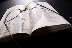 Spectacles and holy bible. Shot with dramatic lighting Royalty Free Stock Photos