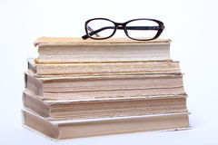 Spectacles lying on old book Royalty Free Stock Image