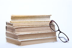 Spectacles lying on old book Stock Photo