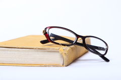Spectacles lying on old book Royalty Free Stock Photography