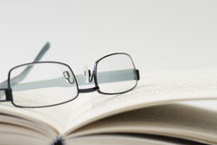 Spectacles on an open book Royalty Free Stock Images