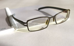 Spectacles. A pair of glasses on a notepad royalty free stock images