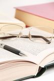 Spectacles and pen on the book Royalty Free Stock Images