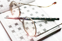 Spectacles, pencil, crossword Royalty Free Stock Photos