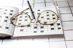 Spectacles, pencil, crossword Stock Image