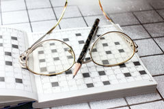 Spectacles, pencil, crossword Royalty Free Stock Photo