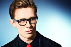 Spectacles. Portrait of a handsome young man in elegant suit and spectacles Royalty Free Stock Image