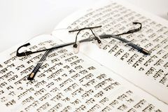 Spectacles with siddur. On isolated background Stock Photo