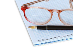 Spectacles On Spiral Notebook Royalty Free Stock Image