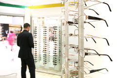 Spectacles store. Customer in a spectacles store Stock Images