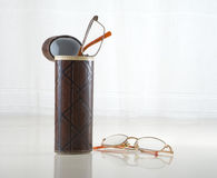 Spectacles and tube Stock Images