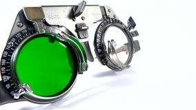 Spectacles used for eyesight tests with various lenses and green filter lens Stock Images