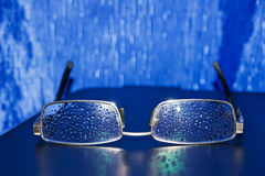 Spectacles of water droplets on the glasses Stock Photos