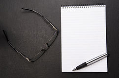 Spectacles and wriring pad. With lots of copy space Stock Images