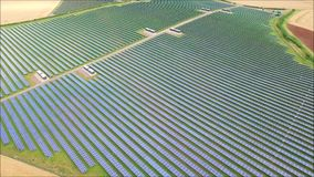 Spectacular aerial drone view on futuristic modern urban green field eco solar energy panel renewable power station. Fascinating aerial drone view on futuristic stock video