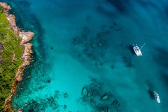 Spectacular aerial view of coastline and turquoise sea, Seychelles in the Indian Ocean.Top view from drone.  stock photography