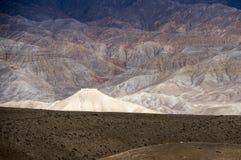 Spectacular altitude desert of Mustang. Desert mountains. Gradient ocher and brown colors. Light and shadow. Upper Mustang, tibetan Nepal, Himalaya Stock Photo