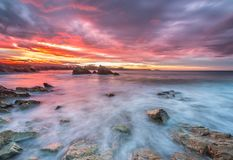 Free Spectacular And Colorful Sunset On The Beach Of Arnao Royalty Free Stock Images - 106607729