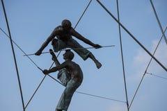 Spectacular Balanced Bronze statues of Athletes on the Bernatka Footbridges over the River Vistula in Krakow Poland Royalty Free Stock Image