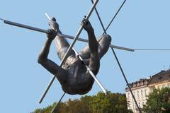 Spectacular Balanced Bronze statues of Athletes on the Bernatka Footbridges over the River Vistula in Krakow Poland Royalty Free Stock Photo