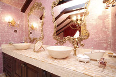 Spectacular bathroom with classy mirrors Stock Images
