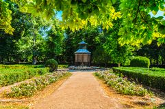 Spectacular beautiful garden with a birdhouse in the center. stock images