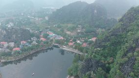 Beauty Of The River Mountain. The Spectacular Beauty of the River, Tam Coc - Bich Dong is considered the most attractive tourist destination in Ninh Binh, known stock footage